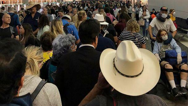 PHOTO: People wait in line to go through the customs at Dallas Fort Worth International Airport in Grapevine, Texas, March 14, 2020. (Austin Boschen via AP)