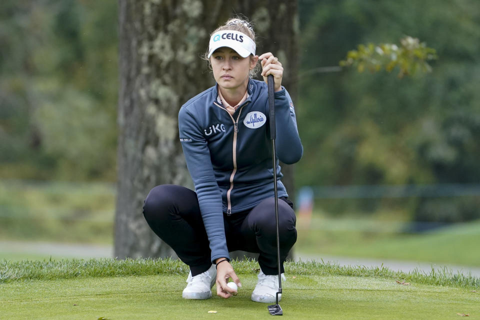 Nelly Korda sets up her shot on the fourth green in the first round of the Cognizant Founders Cup LPGA golf tournament, Thursday, Oct. 7, 2021, in West Caldwell, N.J. (AP Photo/John Minchillo)