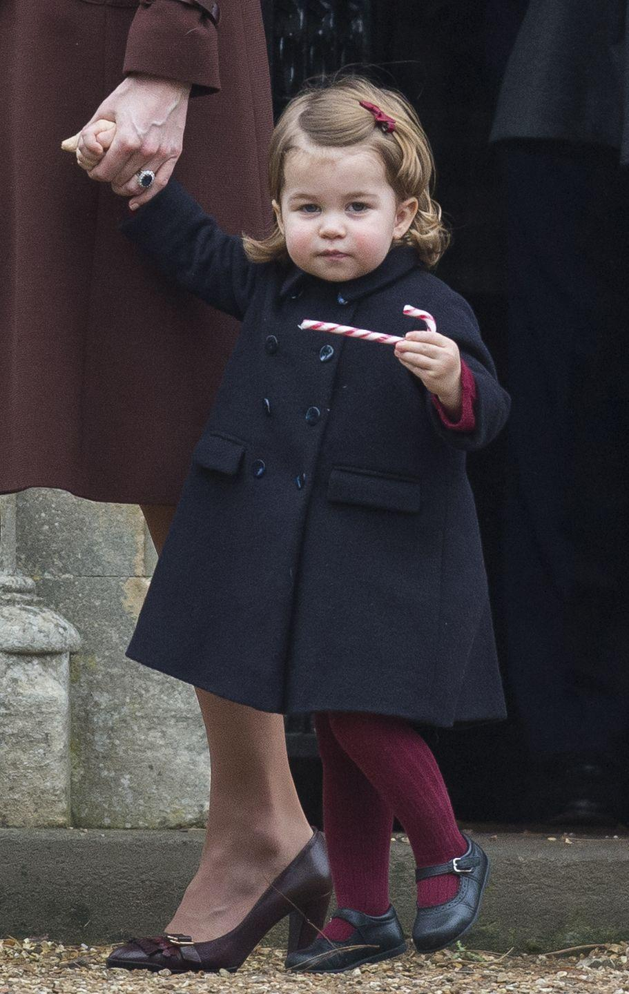 <p>While spending the holidays with Kate Middleton's family in Berkshire, Princess Charlotte shows off the candy cane she received at their Christmas church service.</p>