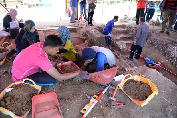 The USM archaeological team excavating the Guar Kepah site.