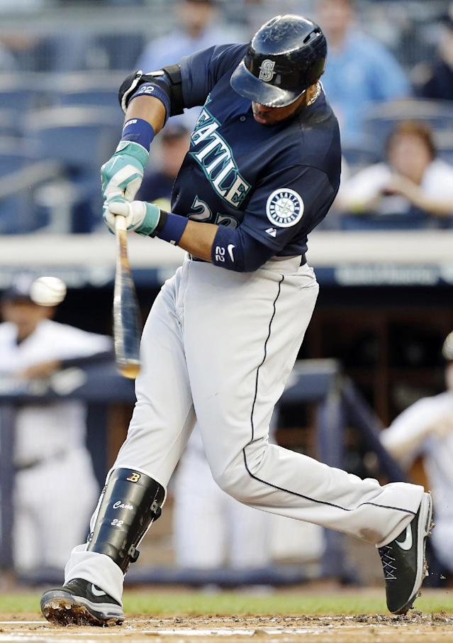 Seattle Mariners' Robinson Cano hits an RBI double during the first inning of a baseball game against the New York Yankees, Thursday, May 1, 2014, in New York. (AP Photo/Frank Franklin II)