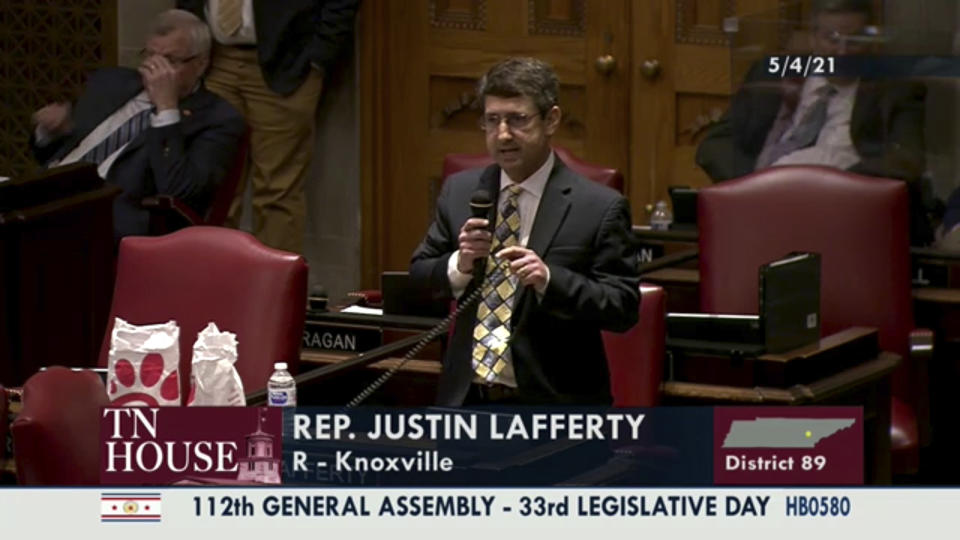 "In this still image from video provided by the Tennessee General Assembly, Rep. Justin Lafferty, R-Knoxville, speaks on the floor of the House of Representatives at the State Capitol in Nashville, Tenn., on Tuesday, May 4, 2021. Lafferty falsely declared that an 18th century policy designating a slave as three-fifths of a person was adopted for ""the purpose of ending slavery,"" commenting amid a debate over whether educators should be restricted while teaching about systematic racism in America. (Tennessee General Assembly via AP)"