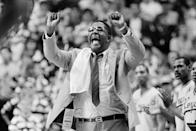 FILE - In this March 30, 1985, file photo, Georgetown coach John Thompson shouts to the floor during the Hova's NCAA semifinal game against St. John's at Rudo Arena in Lexington, Ky. John Thompson, the imposing Hall of Famer who turned Georgetown into a Hoya Paranoia powerhouse and became the first Black coach to lead a team to the NCAA mens basketball championship, has died. He was 78 His death was announced in a family statement Monday., Aug. 31, 2020. No details were disclosed. (AP Photo/File)