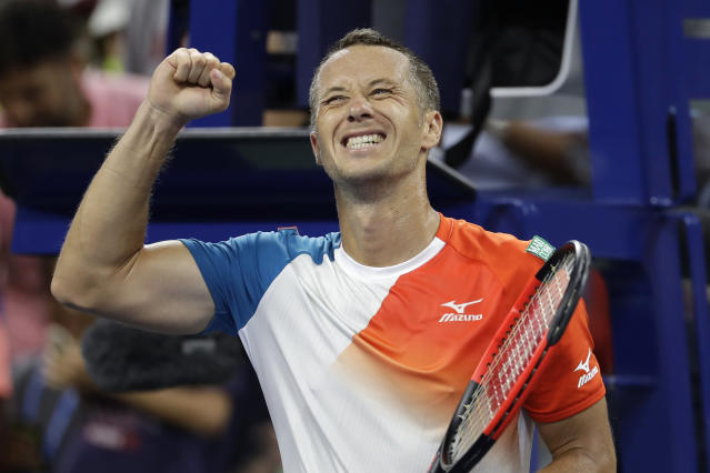 Phillip Kohlschreiber, of Germany, reacts after defeating Alexander Zverev, of Germany, in a third-round match at the U.S. Open tennis tournament, Saturday, Sept. 1, 2018, in New York. (AP Photo/Mark Lennihan)
