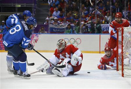 Finland's Selanne scores on Russia's goalie Varlamov during the first period of their men's quarter-finals ice hockey game at the Sochi 2014 Winter Olympic Games