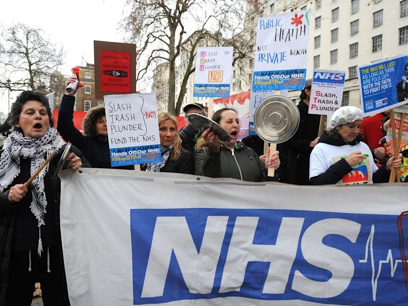 Campaigners at a Hands Off Our NHS demonstration in December: Press Association