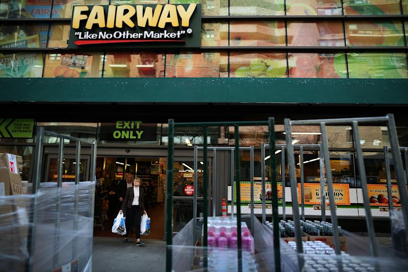 Customers exit a Fairway Group Holdings Corp. market in New York.