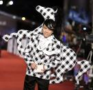 Taiwanese host Kevin Tsai poses for photographers on the red carpet at the 50th Golden Horse Film Awards in Taipei November 23, 2013. REUTERS/Patrick Lin (TAIWAN)