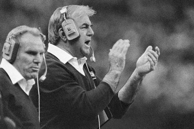 FILE - In this Dec. 13, 1982, file photo, Seattle Seahawks head coach Mike McCormack claps his hands while shouting encouragement to his players during an NFL football game against the Chicago Bears in the Kingdome in Seattle. McCormack, a Hall of Fame offensive lineman died Fridaym, Nov. 15, 2013, in Palm Desert, Calif. He was 83. During his nearly 50 years in professional football, McCormack played, coached and held several executive positions. (AP Photo/Dave Ekren, File)