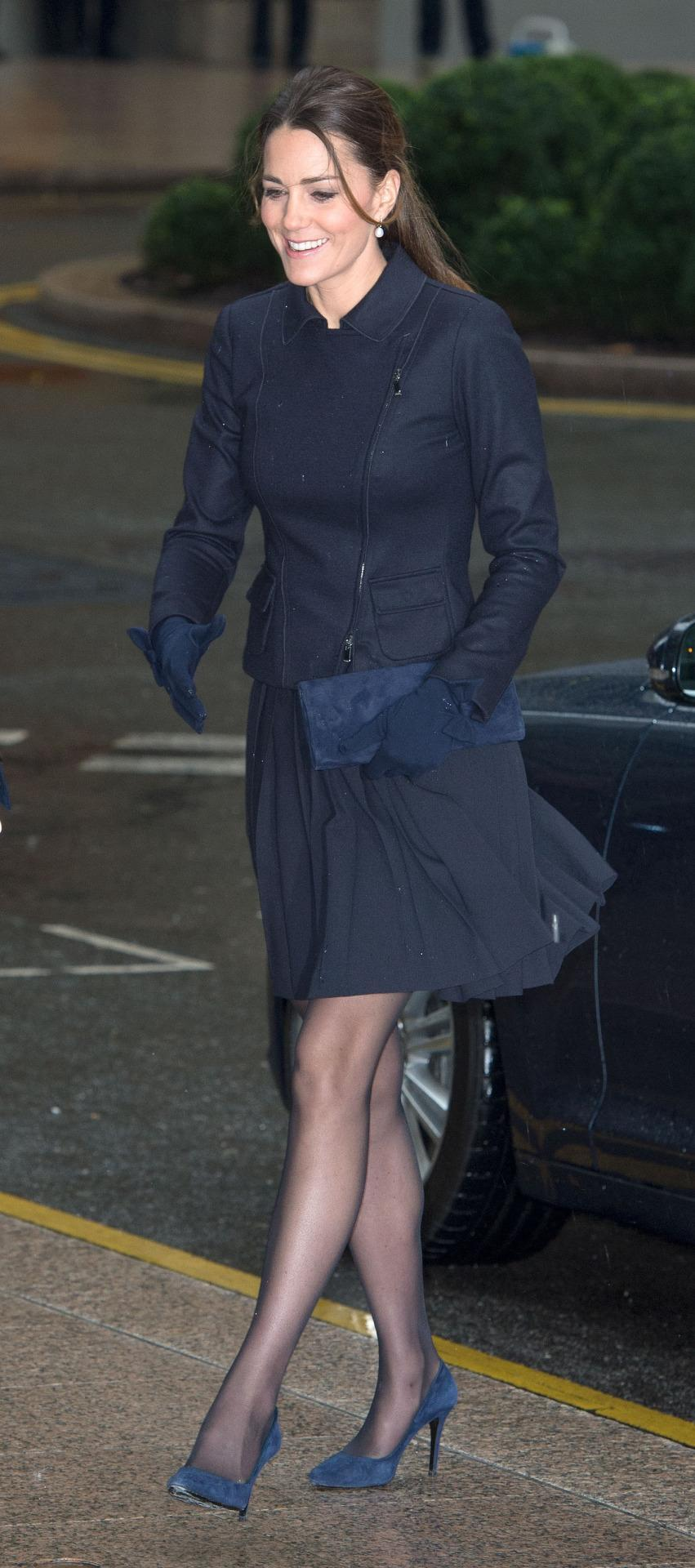 <p>Kate went for a navy ensemble for a charity event in London. Wearing a pleated skirt by Orla Kiely teamed with a Max Mara top, the Duchess carried a matching bag by Stuart Weitzman and Alexander McQueen pumps. </p><p><i>[Photo: PA]</i></p>