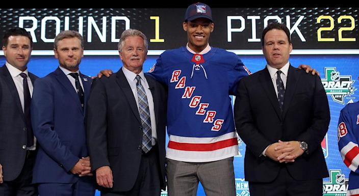 K'Andre Miller poses after being selected 22nd overall by the New York Rangers. (Photo by Bruce Bennett/Getty Images)