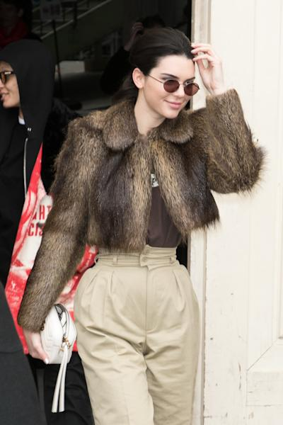 On a recent outing in Los Angeles, Kendall Jenner stepped out wearing a pair of yellow paper-bag waist pants.