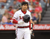 Los Angeles Angels' Shohei Ohtani walks to the dugout after striking out during the first inning of the team's baseball game against Oakland Athletics on Friday, July 30, 2021, in Anaheim, Calif. (AP Photo/John McCoy)