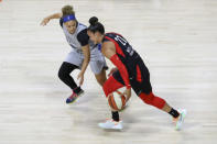 Las Vegas Aces' Kayla McBride (21) steals the ball from Minnesota Lynx's Rachel Banham during the first half of a WNBA basketball game Thursday, Aug. 13, 2020, in Bradenton, Fla. (AP Photo/Mike Carlson)