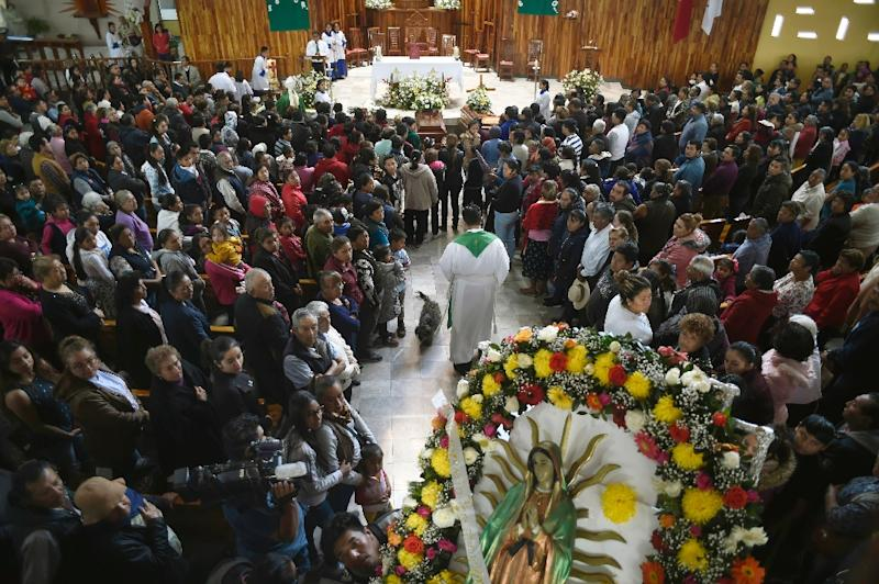 Relatives of three of the people killed in a massive blaze triggered by a leaky pipeline in Tlahuelilpan, Mexico attend their funeral on January 20, 2019