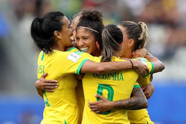 Cristiane of Brazil celebrates with teammates after scoring her team's third goal during the 2019 FIFA Women's World Cup France group C match between Brazil and Jamaica at Stade des Alpes on June 09, 2019 in Grenoble, France. (Photo by Elsa/Getty Images)