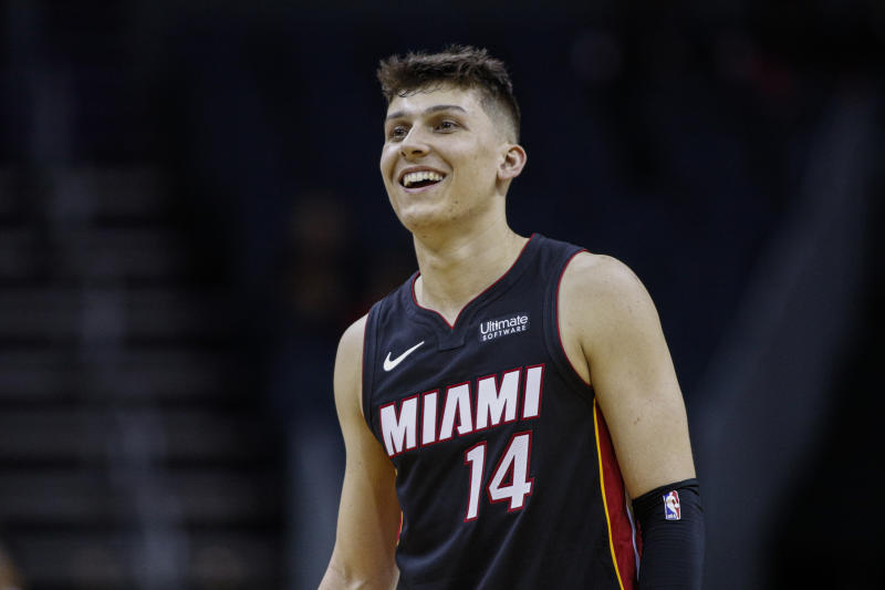 Miami Heat guard Tyler Herro stands on the court during a break in the action against the Charlotte Hornets in the second half of an NBA preseason basketball game in Charlotte, N.C., Wednesday, Oct. 9, 2019. Miami won 108-94. (AP Photo/Nell Redmond)