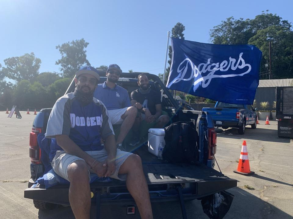Cousins Anish Patel, Rickesh Patel and Vickash Keval set up a lounge chair and bean bag in the bed of Anish's pickup truck.