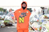 <p>Nick Cannon lends a helping hand at the Feed Your City food drive in L.A. on Saturday. </p>