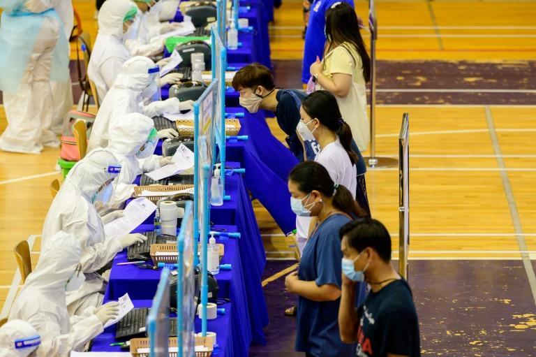 Bangkok residents get free Covid-19 tests at a city stadium