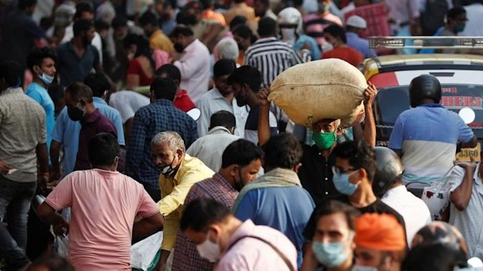 People are seen at a crowded market amidst the spread of the coronavirus disease (COVID-19) in Mumbai, India, October 29, 2020.