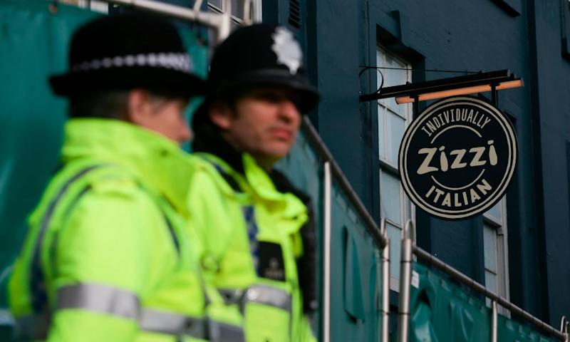 Police officers by the branch of Zizzi vistied by the Skripals. Fellow diners have been advised to wash their clothes.