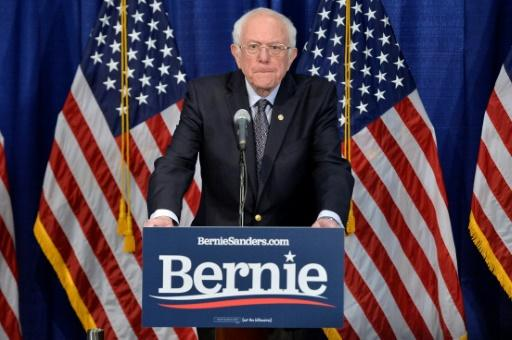US Democratic presidential candidate Senator Bernie Sanders is remaining in the race, and will debate Joe Biden this weekend without a live audience due to coronavirus