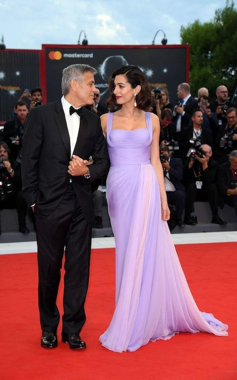 Amal Clooney walks the red carpet in Atelier Versace with George Clooney