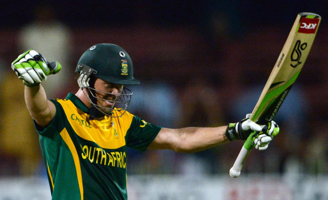 South African captain AB de Villiers celebrates after making his century 100 runs during the fifth and final one-day against Pakistan at the Sharjah Cricket Stadium in Sharjah on November 11, 2013. South Africa are winning the five-match series with an unbeatable 3-1 lead. AFP PHOTO/ASIF HASSAN