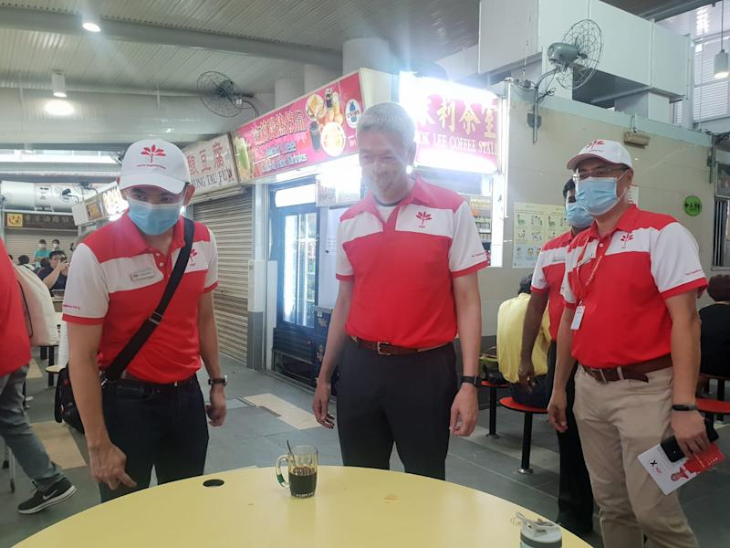 Progress Singapore Party's Tanjong Pagar GRC candidates Terence Soon (left) and Michael Chua (right), as well as party member Lee Hsien Yang (centre), during the walkabout at ABC Brickworks Hawker Centre. (PHOTO: Wan Ting Koh/Yahoo News Singapore)