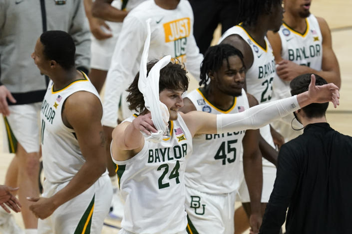 Baylor guard Matthew Mayer (24) celebrates during the first half of a men's Final Four NCAA college basketball tournament semifinal game against Houston, Saturday, April 3, 2021, at Lucas Oil Stadium in Indianapolis. (AP Photo/Darron Cummings)