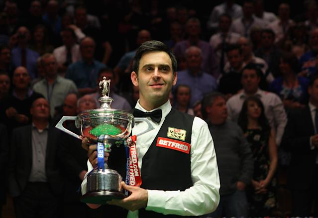 SHEFFIELD, ENGLAND - MAY 07: Ronnie O'Sullivan of England poses with the trophy after beating Allister Carter of England in the final of the Betfred.com World Snooker Championship at the Crucible Theatre on May 7, 2012 in Sheffield, England. (Photo by Warren Little/Getty Images)