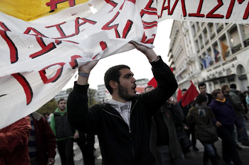 Protesters chant slogans during a rally in Athens on Saturday, Nov. 17, 2012. Several thousand marchers are commemorating the 39th anniversary of a deadly student uprising against the then ruling dictatorship, with more than 6,000 police deployed in the center of the Greek capital.(AP Photo/Petros Giannakouris)
