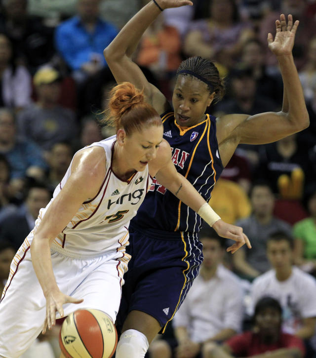 FILE - In this June 25, 2010, file photo, Seattle Storm's Lauren Jackson, left, tries to drive past Indiana Fever's Tamika Catchings in the first quarter during a WNBA basketball game in Seattle. Catchings, Jackson and Swin Cash are headed to the Women's Basketball Hall of Fame. The trio headline the Class of 2020. (AP Photo/Elaine Thompson, File)
