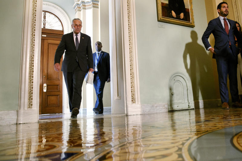 Senate Minority Leader Sen. Chuck Schumer of N.Y., left, arrives to speak to the media about an impeachment inquiry on President Donald Trump, Wednesday Sept. 25, 2019, on Capitol Hill in Washington. (AP Photo/Jacquelyn Martin)