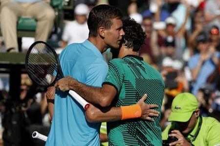 Mar 30, 2017; Miami, FL, USA; Roger Federer of Switzerland (R) hugs Tomas Berdych of the Czech Republic (L) after their match in a men's singles quarter-final during the 2017 Miami Open at Crandon Park Tennis Center. Federer won 6-2, 3-6, 7-6(6). Geoff Burke-USA TODAY Sports