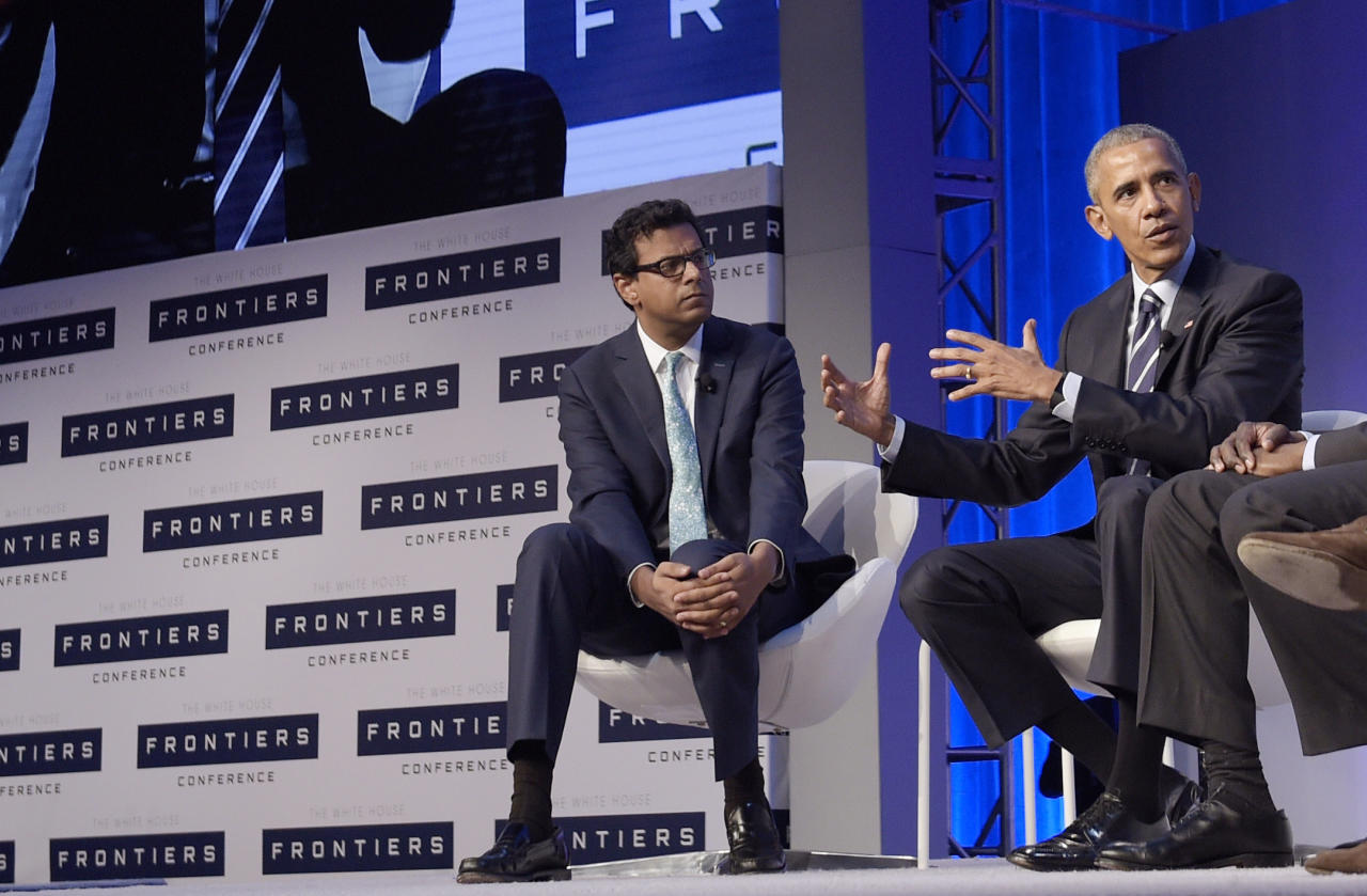 <p> FILE- In this Oct. 13, 2016, file photo, Dr. Atul Gawande, left, listens as President Barack Obama speaks during a panel discussion at the White House Frontiers Conference at Carnegie Mellon University in Pittsburgh. Amazon, JPMorgan Chase and Berkshire Hathaway are turning to well-known author and Harvard professor Gawande to transform the health care they give their employees. The three corporate titans said Wednesday, June 20, 2018, that Gawande will lead an independent company that focuses on a mission they announced earlier this year: figure out ways to provide high-quality, affordable care. (AP Photo/Susan Walsh, File) </p>