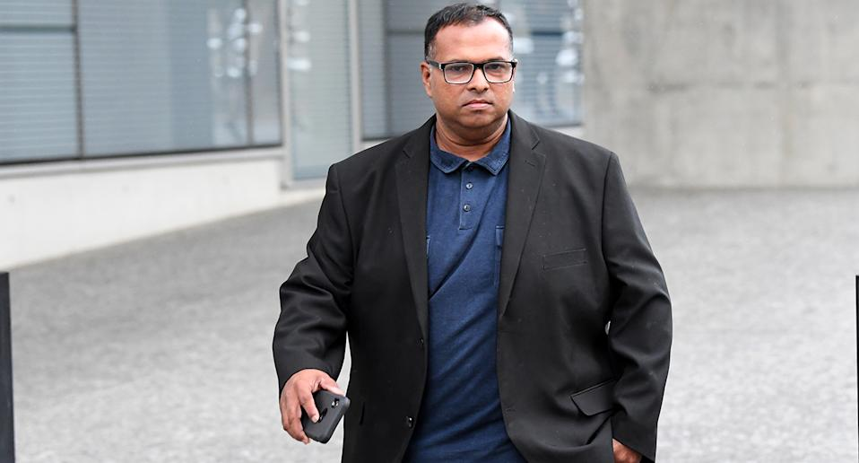 Sampath Samaranayake is seen leaving the Brisbane District Court in Brisbane,  Monday, March 8, 2021. Sampath Sandaruwan Samaranayake is on trial for allegedly pretending to be an Uber driver before allegedly sexually assaulting women. (AAP Image/Darren England) NO ARCHIVING