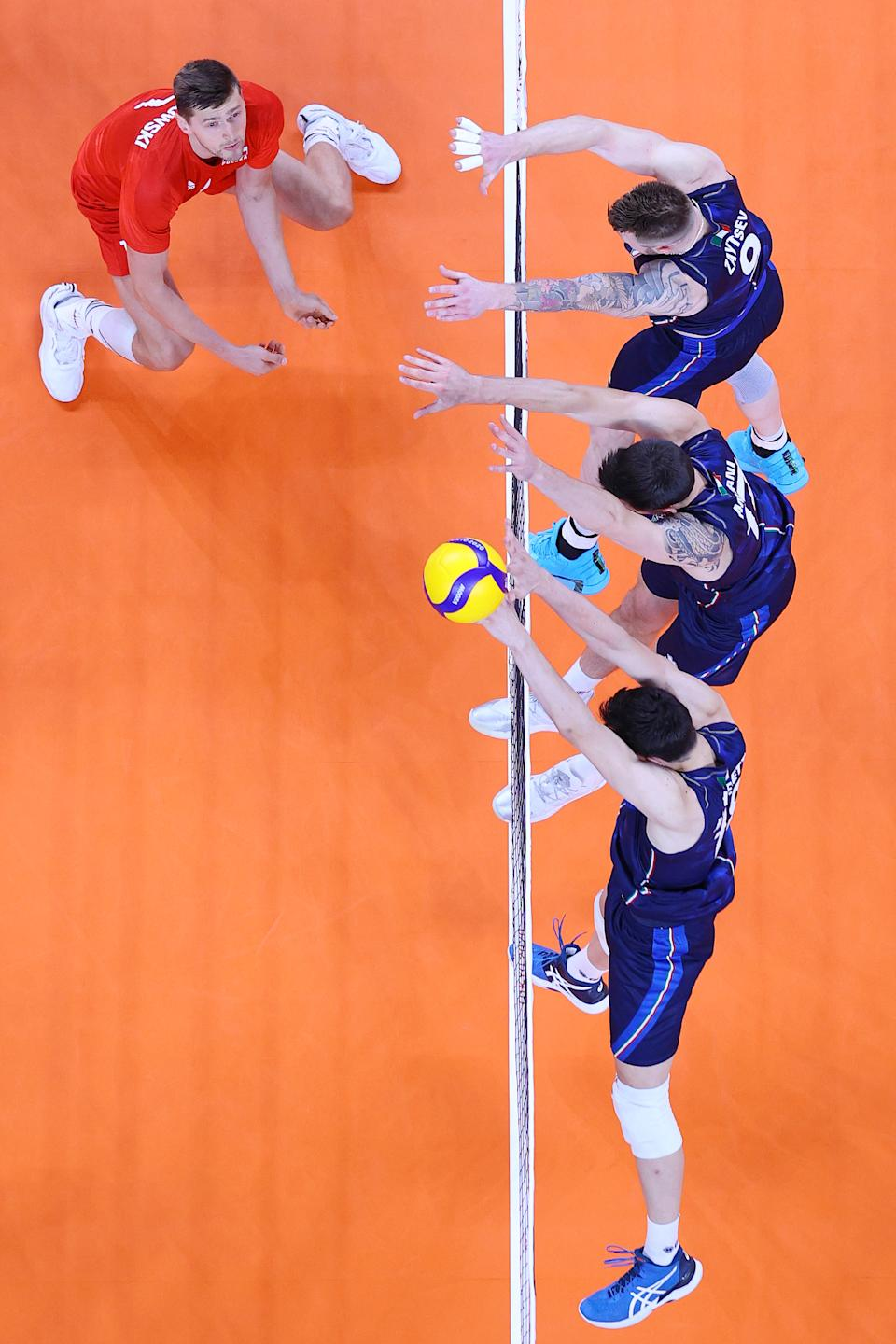 <p>TOKYO, JAPAN - JULY 26: Team Italy blocks the hit by Team Poland during the Men's Preliminary Round - Pool A volleyball on day three of the Tokyo 2020 Olympic Games at Ariake Arena on July 26, 2021 in Tokyo, Japan. (Photo by Toru Hanai/Getty Images)</p>