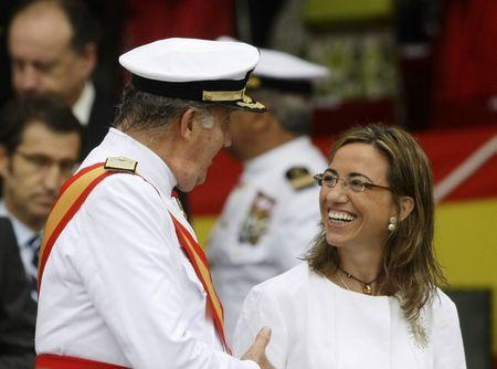 Spanish King Juan Carlos chat with Spanish Minister of Defence Chacon during celebrations for St. Carmen's day at Naval Military School in Marin