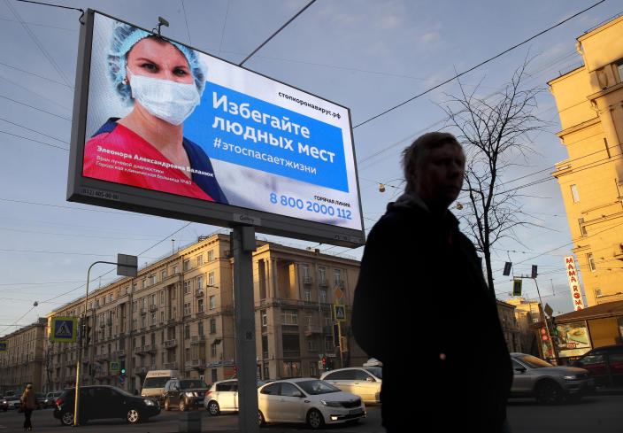"""A billboard in St. Petersburg, Russia, reads: """"Avoid crowded places, it will save a life."""" (Dmitri Lovetsky/AP)"""