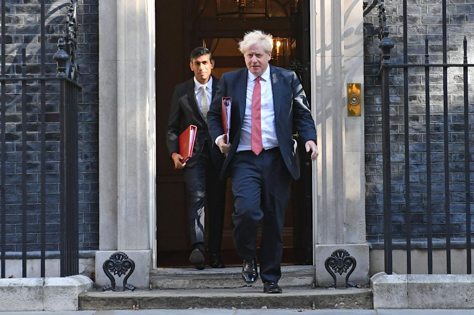 <strong>Chancellor of the Exchequer Rishi Sunak (left) and Prime Minister Boris Johnson leave 10 Downing Street</strong> (Photo: PA)
