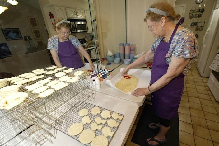 Julie Muller, who sells cookie decorating kits on Etsy, makes cutout cookies for her Black Lives Matter kits Tuesday, Sept. 22, 2020, in Houston. (AP Photo/David J. Phillip)