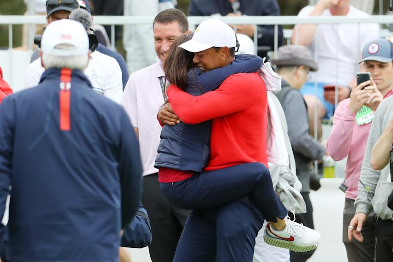 MELBOURNE, AUSTRALIA - DECEMBER 15: Playing Captain Tiger Woods of the United States team celebrates with girlfriend Erica Herman after defeating Abraham Ancer of Mexico and the International team 3&2 during Sunday Singles matches on day four of the 2019 Presidents Cup at Royal Melbourne Golf Course on December 15, 2019 in Melbourne, Australia. (Photo by Warren Little/Getty Images)