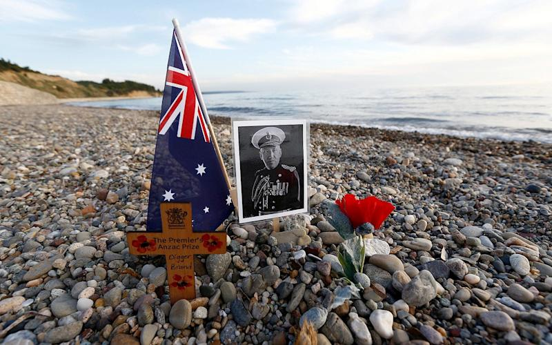 A cross and a picture of an Australian soldier who fought at Gallipoli at Anzac Cove in the Gallipoli peninsula in 2016. - Credit: REUTERS/Murad Sezer