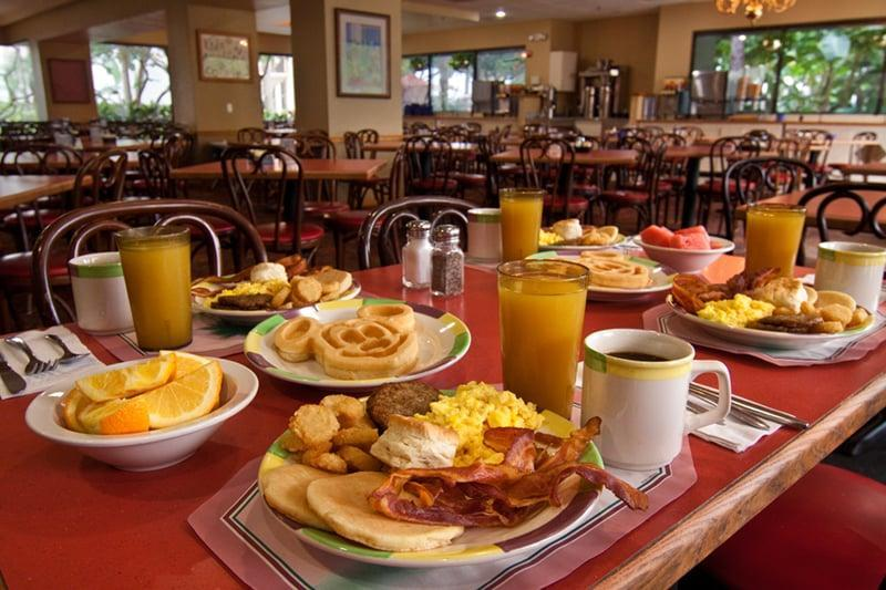 """<p>To always find something for everyone, check out one of the buffets (especially for breakfast - there's nothing better than a Mickey waffle!).</p> <ul> <li><a href=""""https://disneyworld.disney.go.com/dining/beach-club-resort/cape-may-cafe/"""" class=""""link rapid-noclick-resp"""" rel=""""nofollow noopener"""" target=""""_blank"""" data-ylk=""""slk:Cape May Cafe"""">Cape May Cafe</a> (Disney's Beach Club Resort)</li> <li><a href=""""https://disneyworld.disney.go.com/dining/hollywood-studios/hollywood-and-vine/"""" class=""""link rapid-noclick-resp"""" rel=""""nofollow noopener"""" target=""""_blank"""" data-ylk=""""slk:Hollywood &amp; Vine"""">Hollywood &amp; Vine</a> (Hollywood Studios)</li> <li><a href=""""https://disneyworld.disney.go.com/dining/magic-kingdom/crystal-palace/"""" class=""""link rapid-noclick-resp"""" rel=""""nofollow noopener"""" target=""""_blank"""" data-ylk=""""slk:The Crystal Palace"""">The Crystal Palace</a> (Magic Kingdom)</li> <li><a href=""""https://disneyworld.disney.go.com/dining/contemporary-resort/wave-restaurant-of-american-flavors/"""" class=""""link rapid-noclick-resp"""" rel=""""nofollow noopener"""" target=""""_blank"""" data-ylk=""""slk:The Wave . . . of American Flavors"""">The Wave . . . of American Flavors</a>** (Disney's Contemporary Resort)</li> <li><a href=""""https://disneyworld.disney.go.com/dining/grand-floridian-resort-and-spa/1900-park-fare/"""" class=""""link rapid-noclick-resp"""" rel=""""nofollow noopener"""" target=""""_blank"""" data-ylk=""""slk:1900 Park Fare"""">1900 Park Fare</a>** (Disney's Grand Floridian Resort &amp; Spa)</li> <li><a href=""""https://disneyworld.disney.go.com/dining/swan-hotel/garden-grove/"""" class=""""link rapid-noclick-resp"""" rel=""""nofollow noopener"""" target=""""_blank"""" data-ylk=""""slk:Garden Grove"""">Garden Grove</a> (Walt Disney World Swan Hotel)</li> <li><a href=""""https://disneyworld.disney.go.com/dining/animal-kingdom/tusker-house-restaurant/"""" class=""""link rapid-noclick-resp"""" rel=""""nofollow noopener"""" target=""""_blank"""" data-ylk=""""slk:Tusker House Restaurant"""">Tusker House Restaurant</a> (Animal Kingdom)</li> <li><a href=""""https://disneyworld.disney.go.c"""