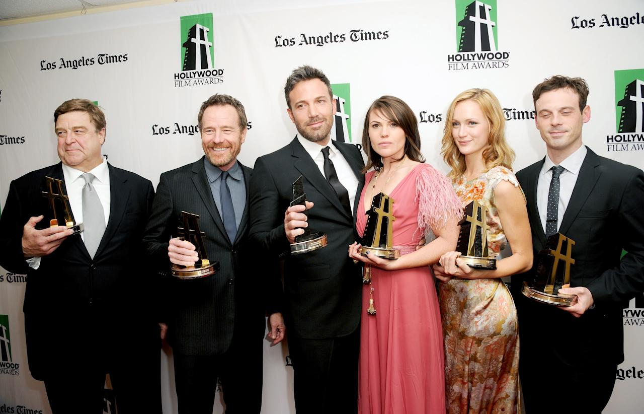 BEVERLY HILLS, CA - OCTOBER 22:  (L-R) Actors John Goodman, Bryan Cranston, Ben Affleck, Clea DuVall, Kerry Bishe and Scoot McNairy, winners of the Hollywood Ensemble Cast Award, pose during the 16th Annual Hollywood Film Awards Gala presented by The Los Angeles Times held at The Beverly Hilton Hotel on October 22, 2012 in Beverly Hills, California.  (Photo by Jason Merritt/Getty Images)
