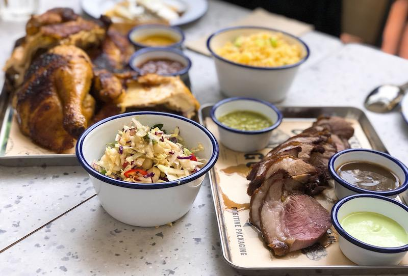 Spit-roasted chicken and lamb shoulder. Photo: Coconuts Media
