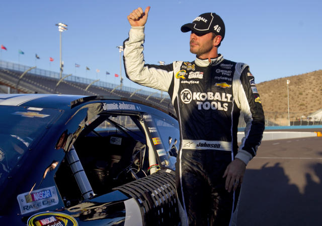 Jimmie Johnson gives a thumbs-up after winning the pole for the NASCAR Sprint Cup Series auto race, Friday afternoon, Nov. 8, 2013, at Phoenix International Raceway in Avondale, Ariz. (AP Photo/The Arizona Republic. David Wallace)