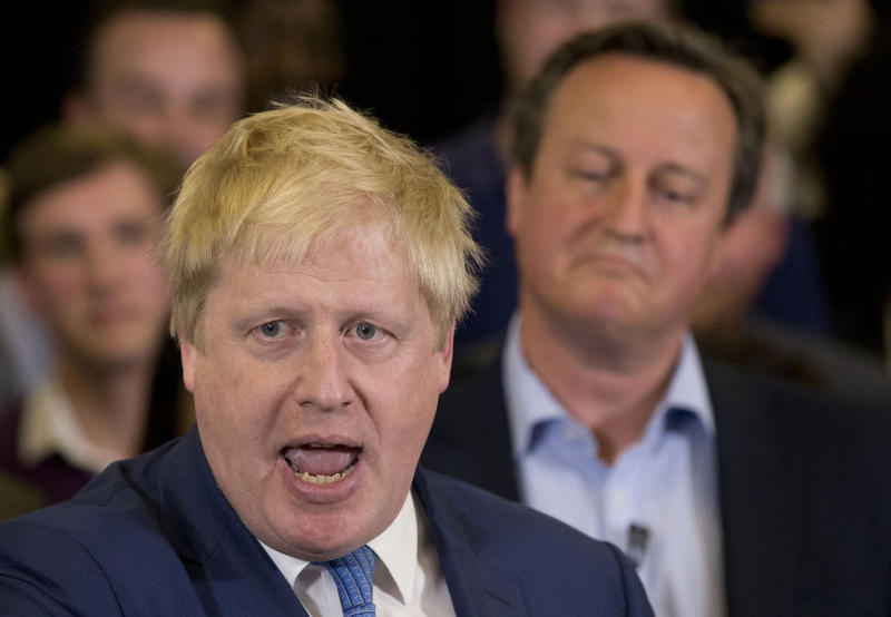 FILE - In this Tuesday, May 3, 2016 file photo Britain's Prime Minister David Cameron, right, listens as then Mayor of London Boris Johnson speaks at a mayoral election campaign rally for Britain's Conservative party candidate for Mayor of London Zac Goldsmith at a school in Ham, a suburb in south west London. (AP Photo/Matt Dunham, File)
